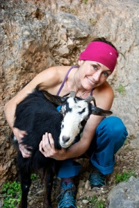 Snuggling with a crag goat