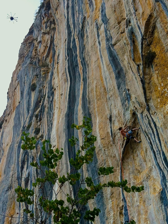 Dave Graham wrestles with a classic tufa line at Citdibi.  Note the drone in the upper left corner.